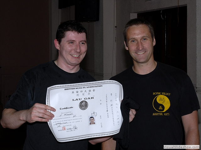 Stephen McDowell receiving his Black Sash and certificate from Sifu Derek Dawson