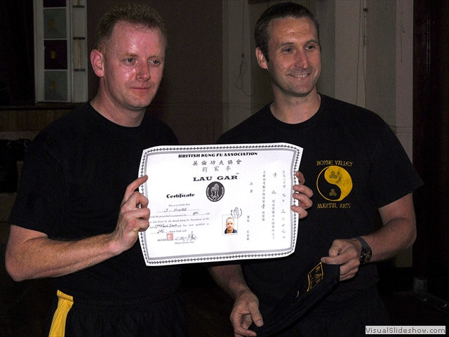 John Hughes receiving his Black Sash and certificate from Sifu Derek Dawson