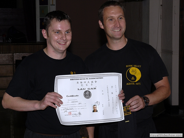Ian Lafford receiving his Black Sash and certificate from Sifu Derek Dawson