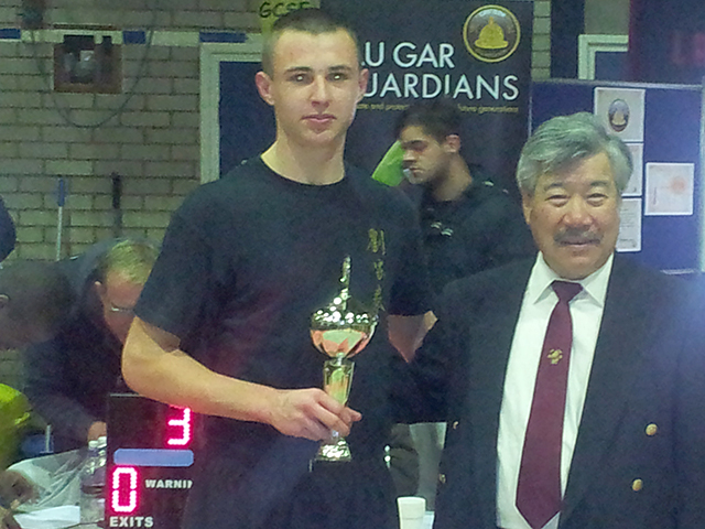 Jake receiving his trophy from Master Yau at the BKFA Nationals