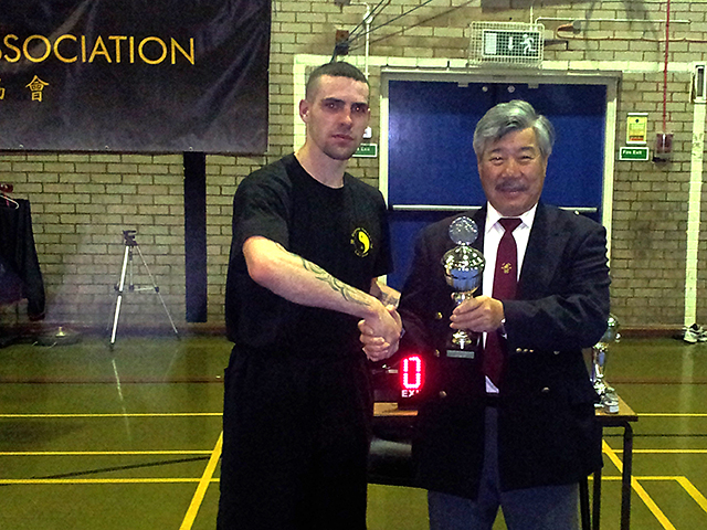Padraig receiving his trophy from Master Yau at the BKFA Nationals