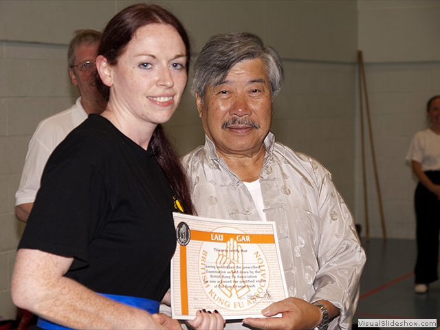 Stephanie Forte receiving her Orange Sash from Master Yau at the Summer Course