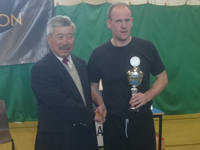 Ian at BKFA Nationals receiving trophy from Master Yau