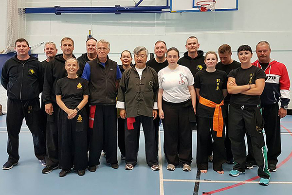 Group photo at the Summer Course with Grand Master Yau, Master John Russell, and Guardian Morag Quirk
