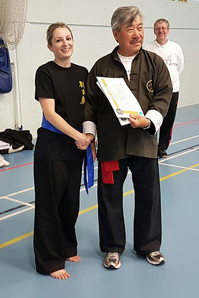 Danielle at the Summer Course, receiving her Orange Sash from Master Yau